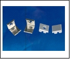 Компл. UFE-N05 SILVER A POLYBAG Набор аксессуаров для алюминиевого профиля. Крепежные скобы (4 шт., сталь) и заглушки (4 шт., пластик). Цвет серебро.